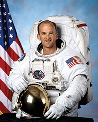 an astronaut who changed his religion